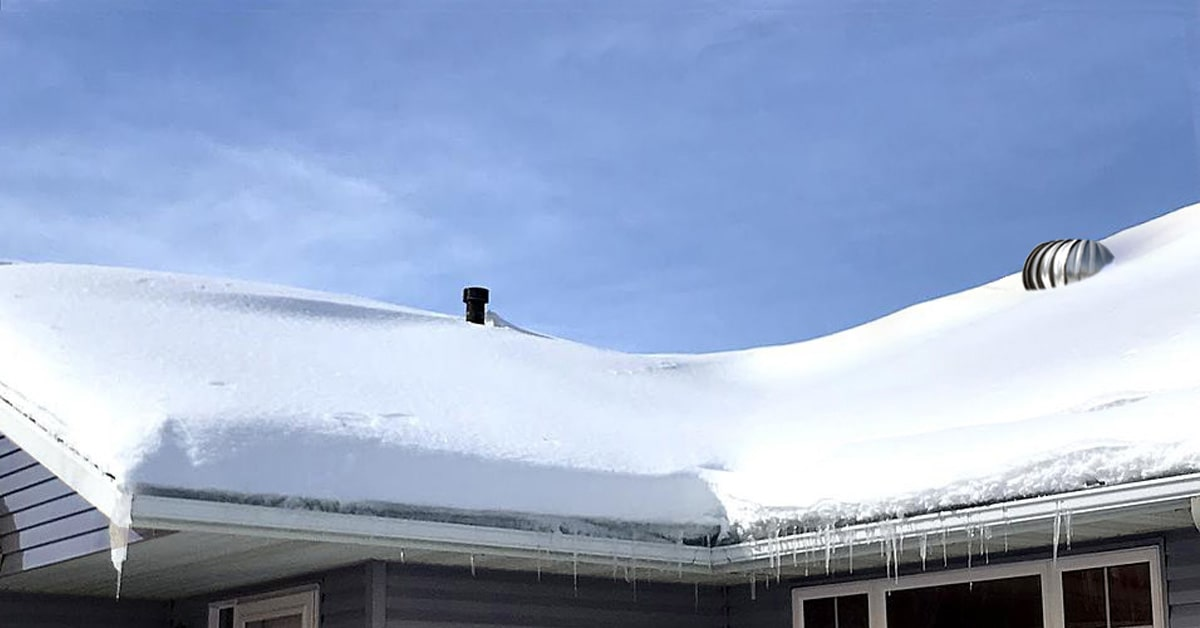 snow covering rooftop and roof vents